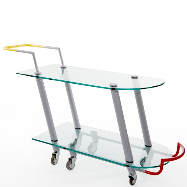 Memphis design style cart with yellow handles designed by Javier Mariscal