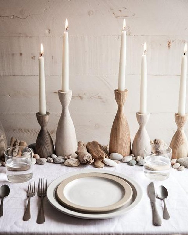 farmhouse table centerpiece idea with wooden candleholders and taper candles