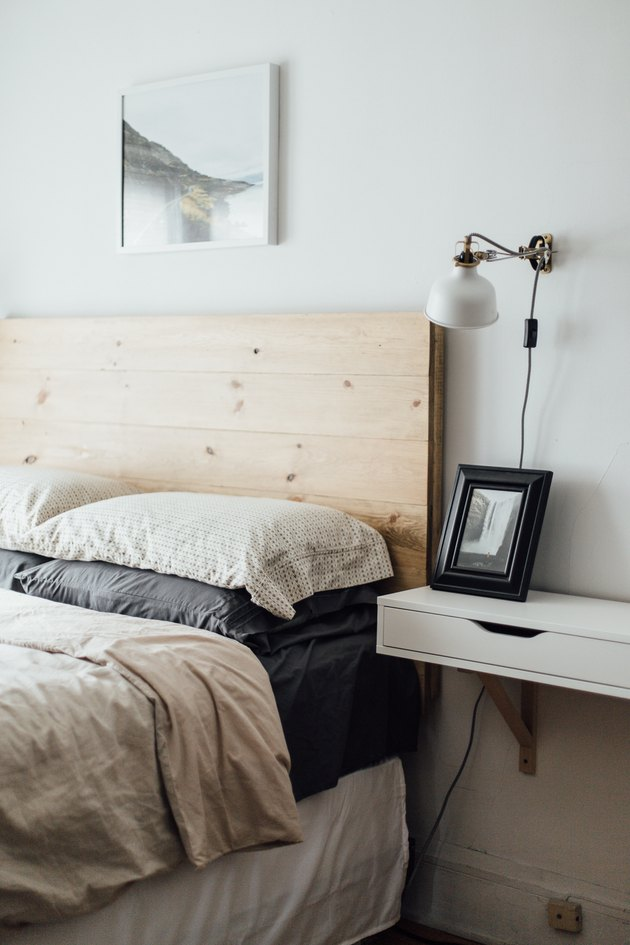 bedroom with wood headboard idea for minimalist decorating on a budget