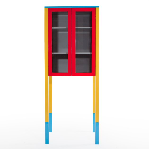 cabinet with bright red door frames and yellow legs with blue tips designed by George Sowden