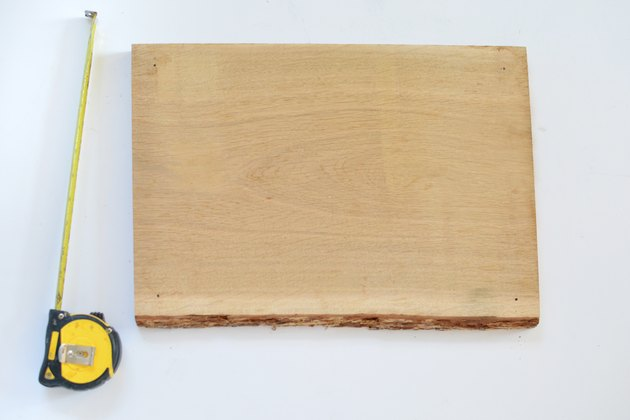 Piece of natural wood and a tape measure