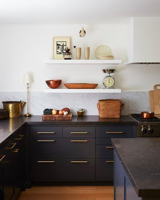 limestone countertops in kitchen with navy blue cabinets