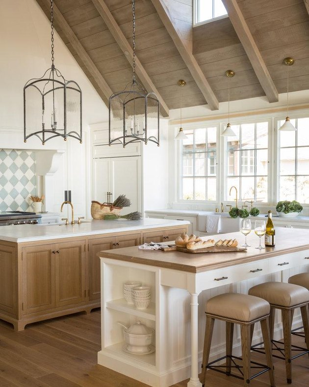 neutral beadboard kitchen island with wood countertop