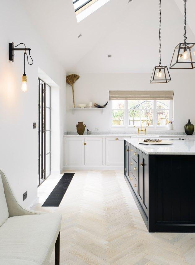 Light wood herringbone kitchen floor in modern, minimalist kitchen