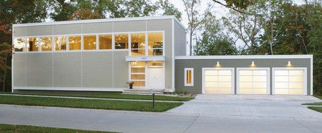 Three full-view garage doors.