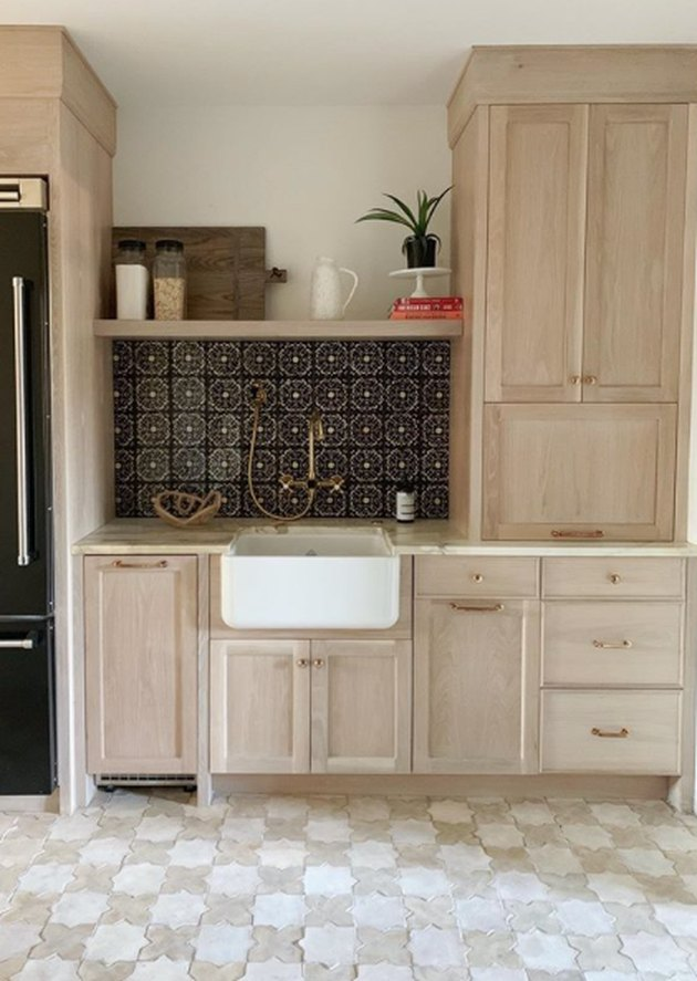 star motif Moroccan kitchen floor tiles with wood cabinets
