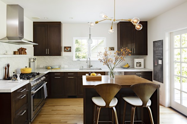 espresso kitchen island in midcentury space with dark cabinets
