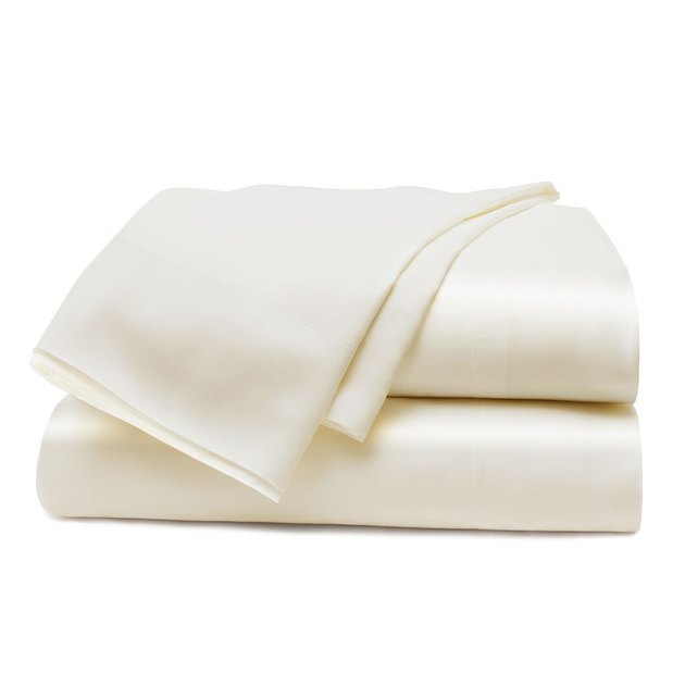 two bed sheets in off white color
