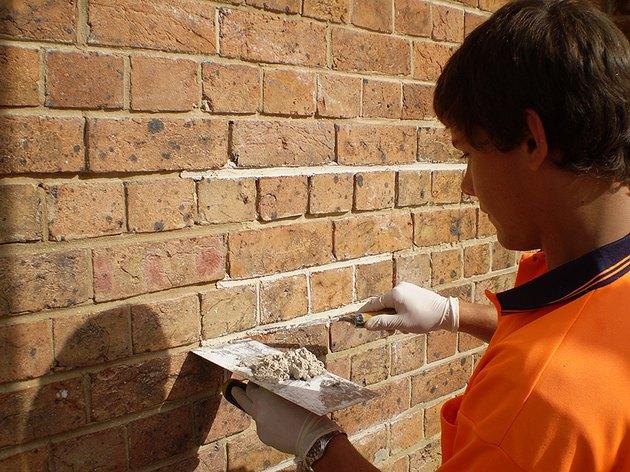 Tuckpointing brick repair.