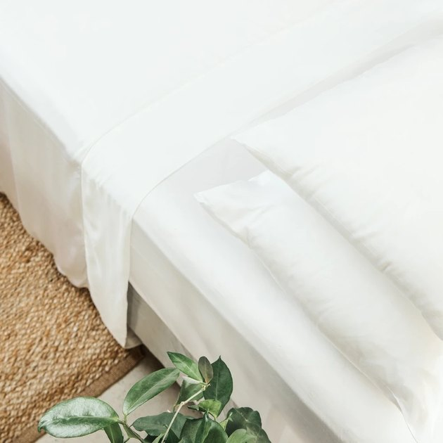 overhead photo of a bed with white sheets