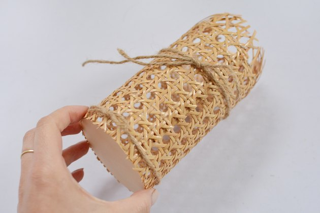 Cane cylinder with jute string wrapped around.