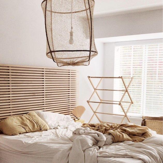 wood slat Scandinavian headboard with white bedding