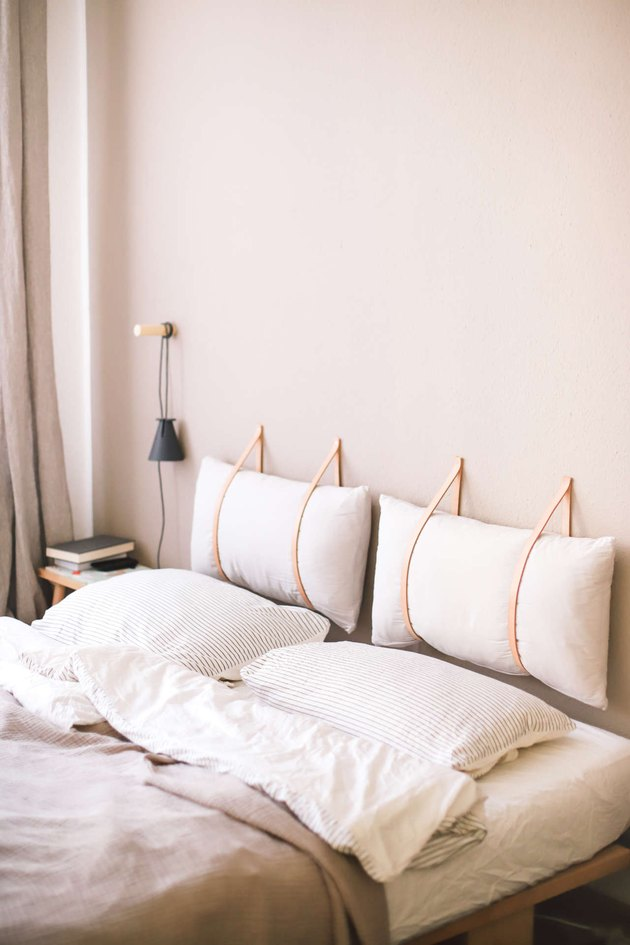DIY Scandinavian headboard with leather straps
