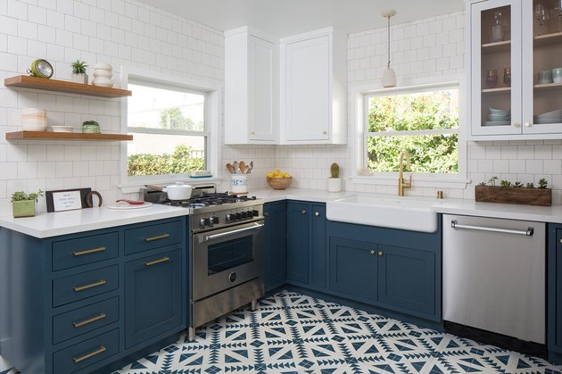 blue kitchen with graphic blue kitchen floor tile and white backsplash