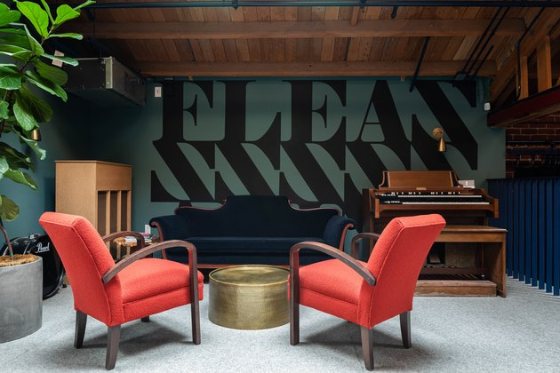 red room ideas with red mid-century modern chairs