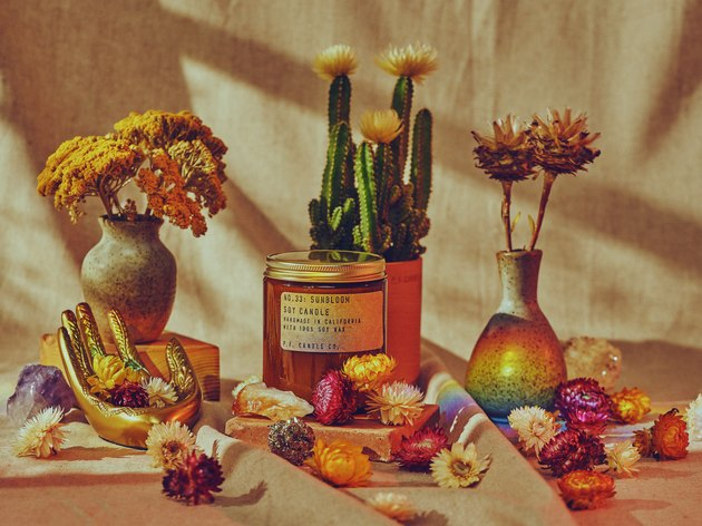 dreamy P.F. Candle Co. product shot with flowers and cacti