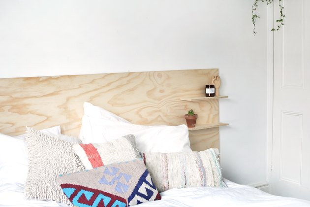 Scandinavian headboard with shelving made of plywood