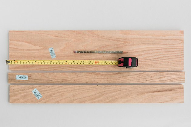 Measure and mark the wood boards down the center of each.