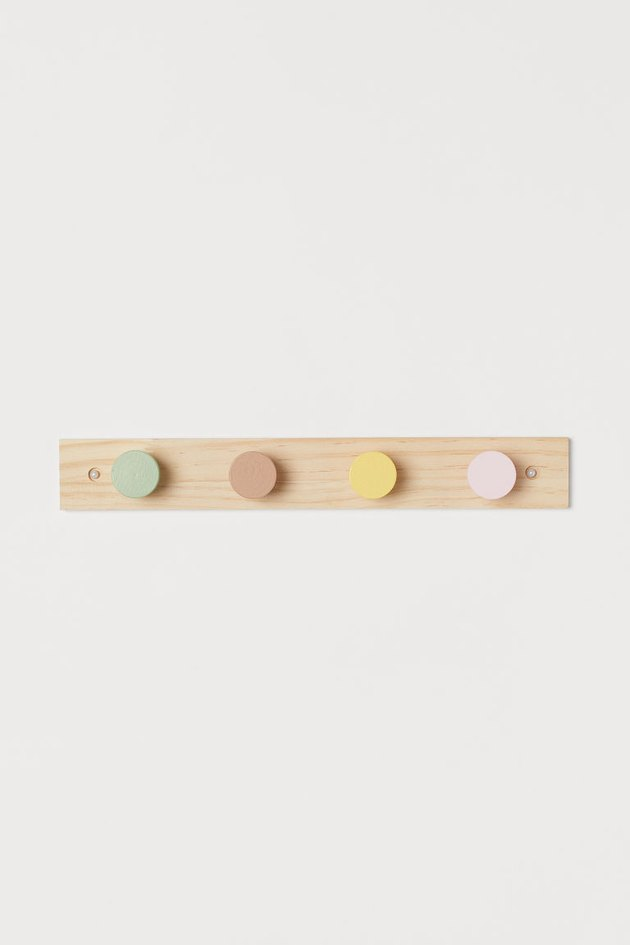 wood hanger with colorful knobs