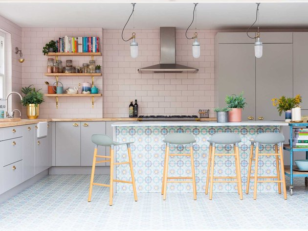 pink and blue encaustic Mexican tile floor in kitchen with pink walls
