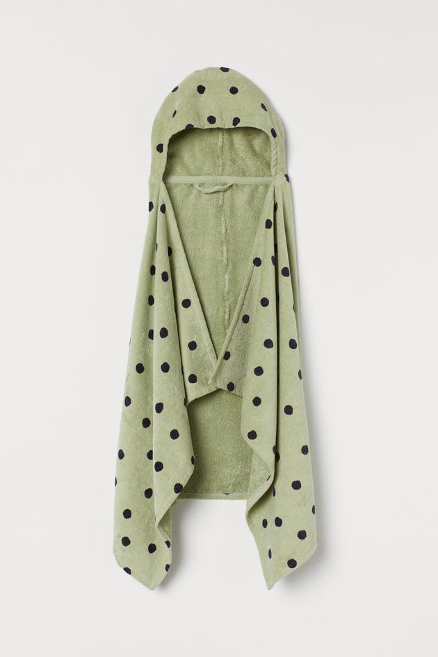 green hooded bath towel with black polka dots