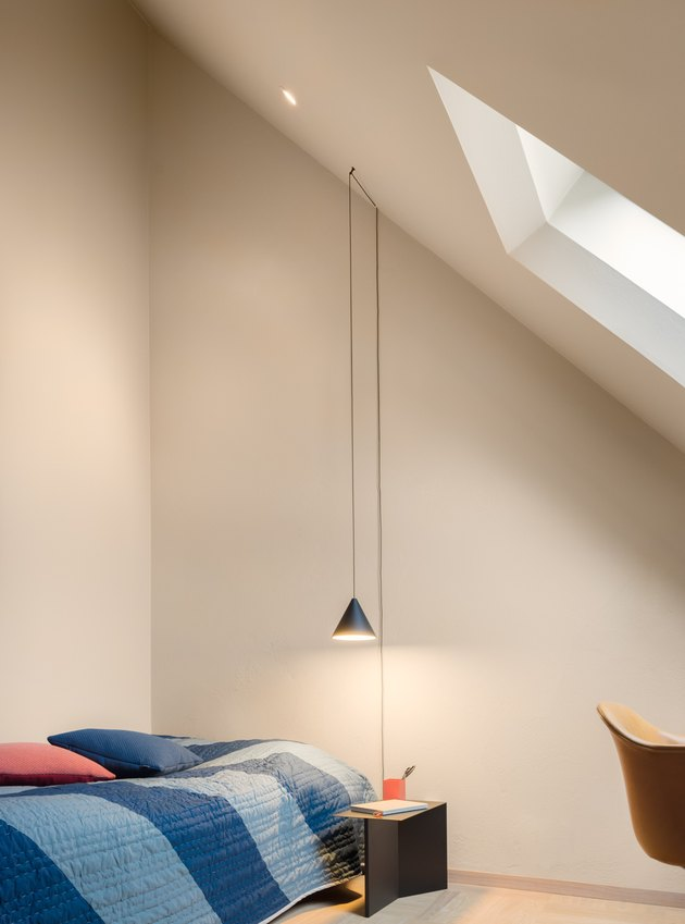Bedroom with pendant light and skylight