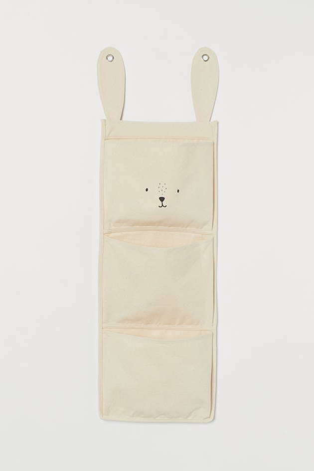 canvas wall organizer with three pockets and bunny face and ears near the top