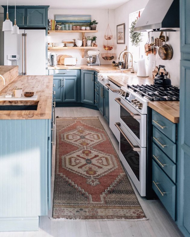 cozy blue kitchen with butcher block countertops