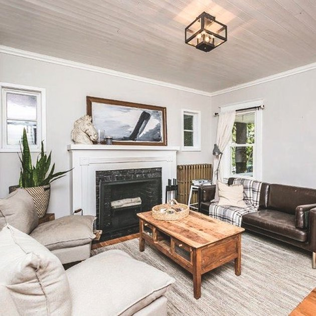 white and black Craftsman style fireplace in living room