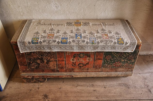 Wooden hope chest featuring elaborate carvings in the Hărman fortified church