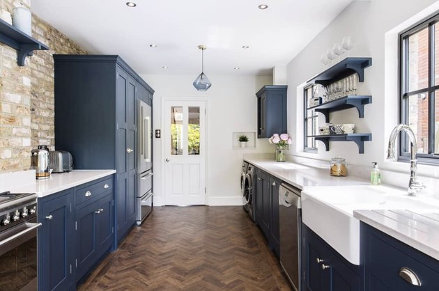 blue shaker-style cabinets with white farm sink