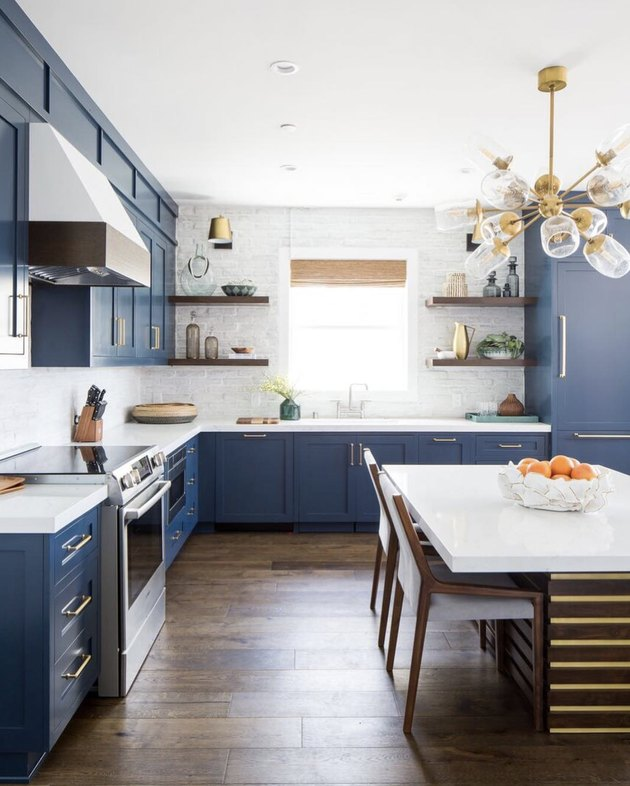 blue shaker-style cabinets with modern gold accents