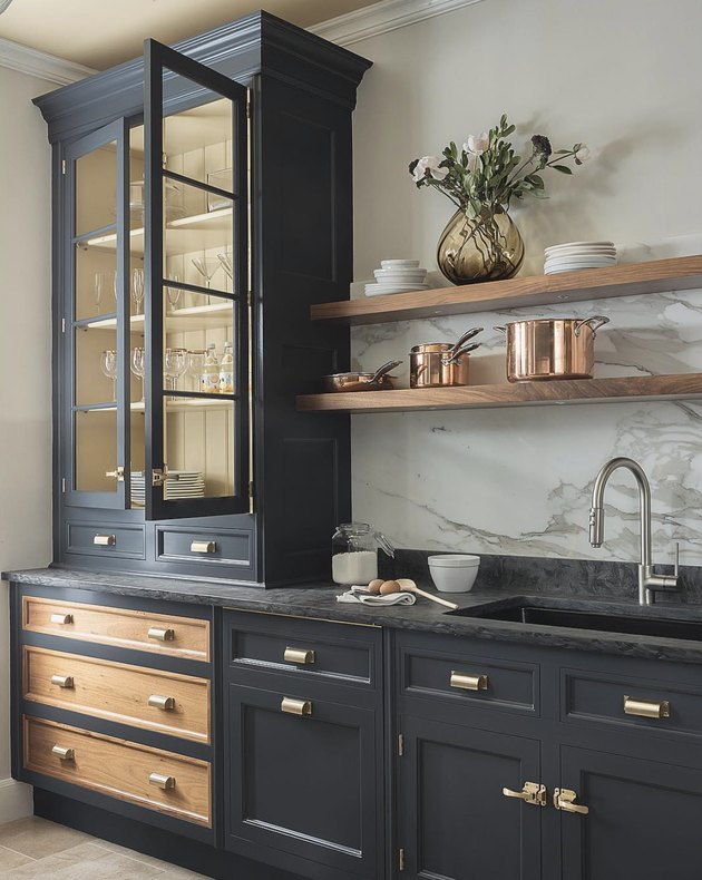 dark navy cabinets with natural wood accents
