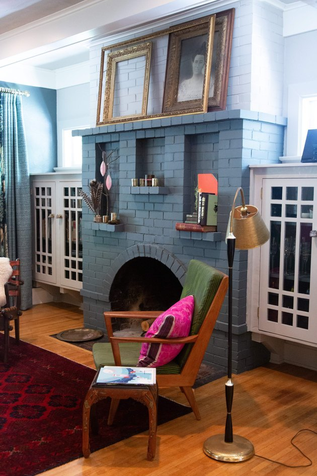 painted brick Craftsman style fireplace in living room