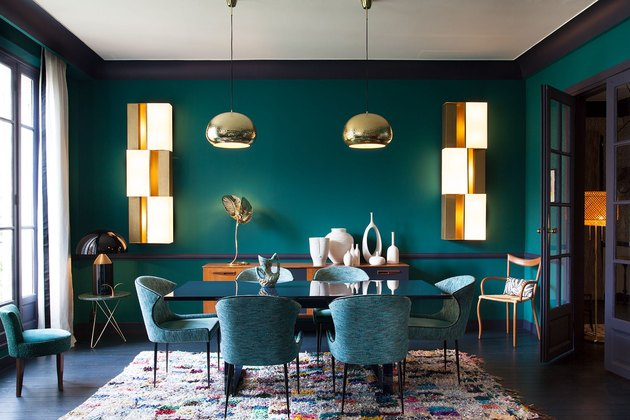 teal dining room with gold accents