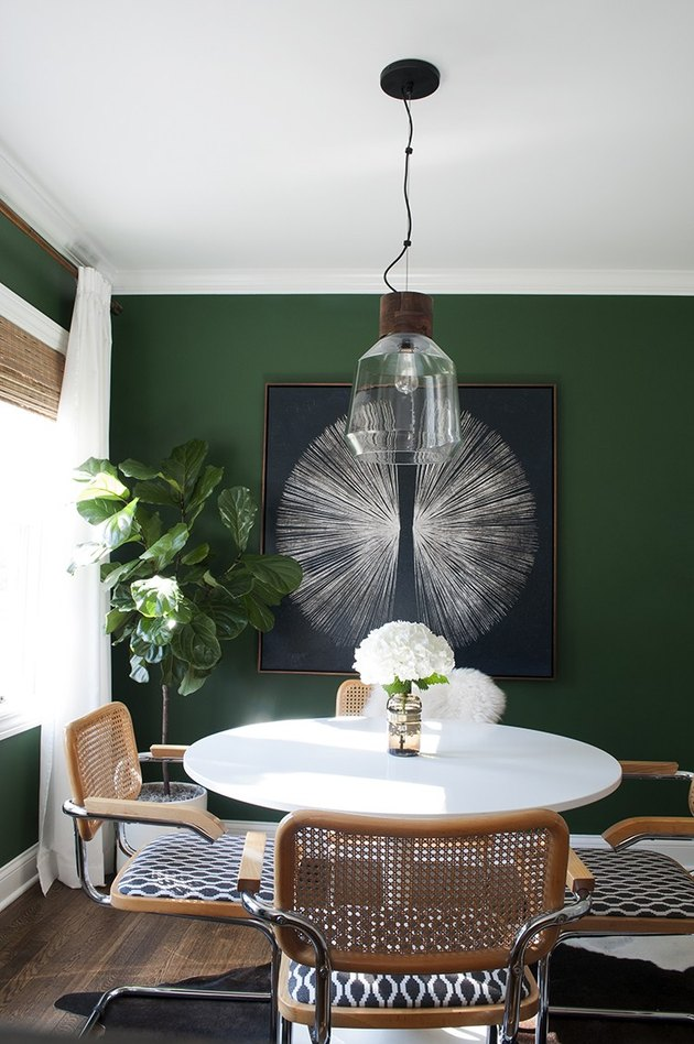 dining room design idea with green walls to divide space