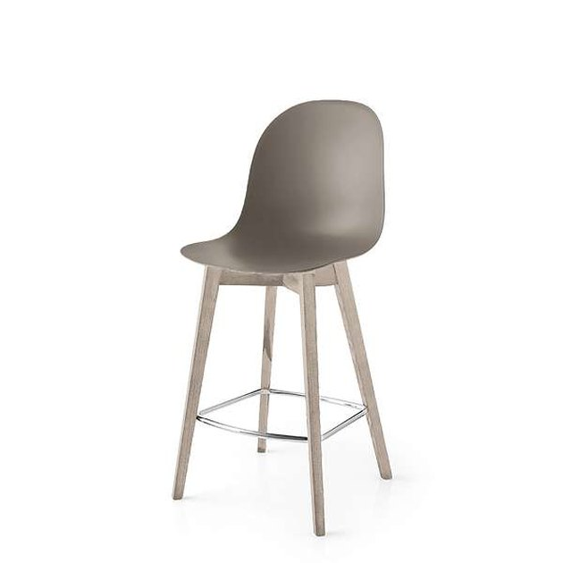 Taupe plastic counterstool with rounded back and blonde wood legs