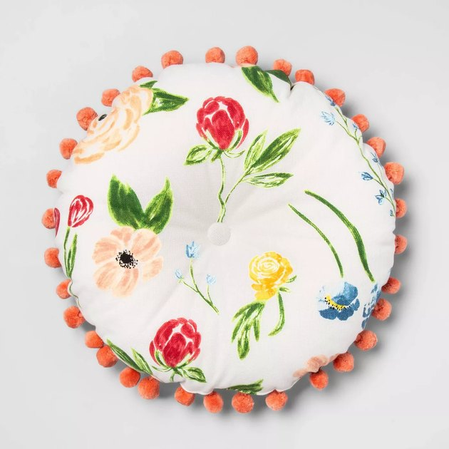 round floral pillow with poms