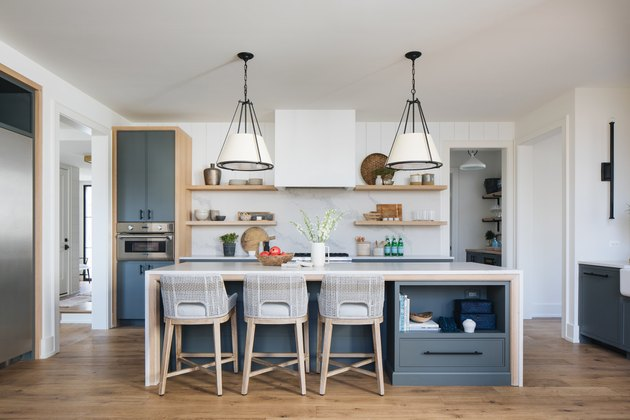 kitchen with gray cabinets and natural wood floors