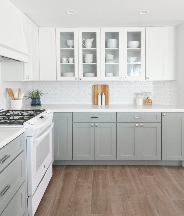 kitchen with gray cabinets and light wood floors