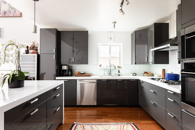 kitchen with gray cabinets and cherry wood floors
