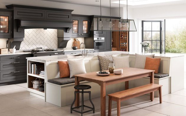 Spacious White L-shaped kitchen island with banquette seating