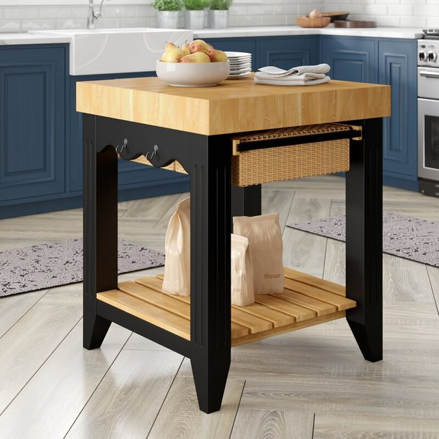 Square kitchen island with butcher block top and storage below