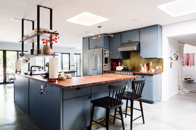 kitchen with gray cabinets and concrete floors