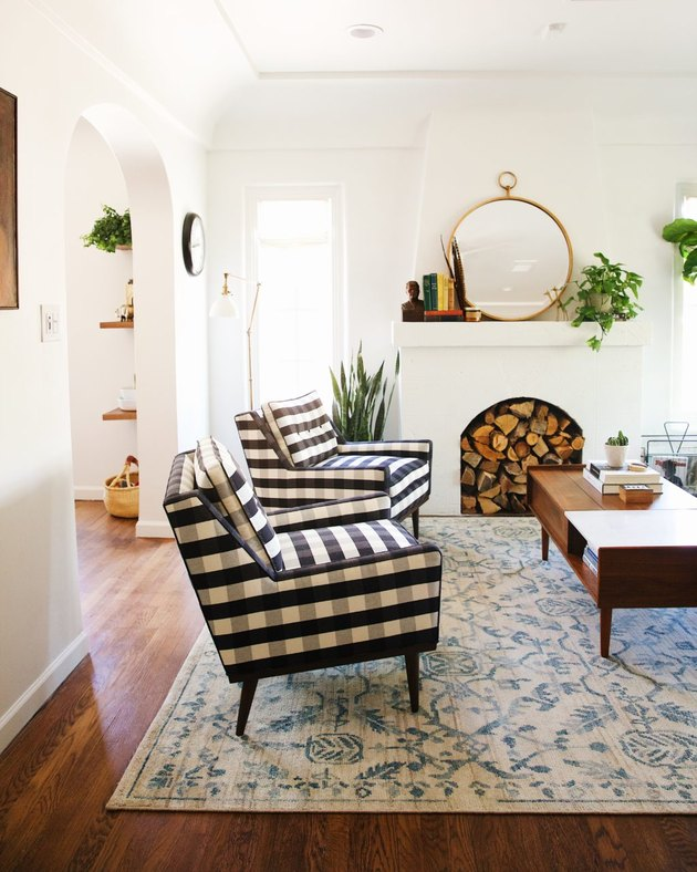 Craftsman living room with white walls and painted white fireplace