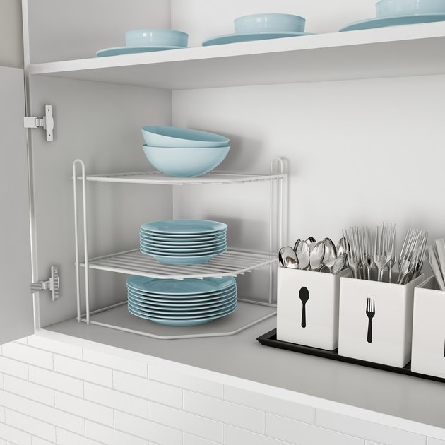 white corner shelf in kitchen cabinet