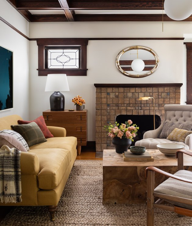 Craftsman living room with brick fireplace and yellow sofa