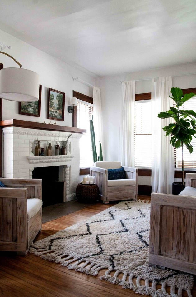 Craftsman living room with original fireplace and vintage artwork
