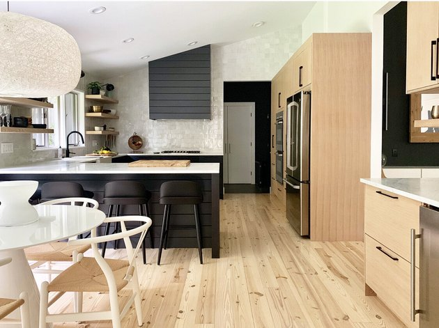 light wood kitchen floors and wood cabinets by Dichotomy Interiors