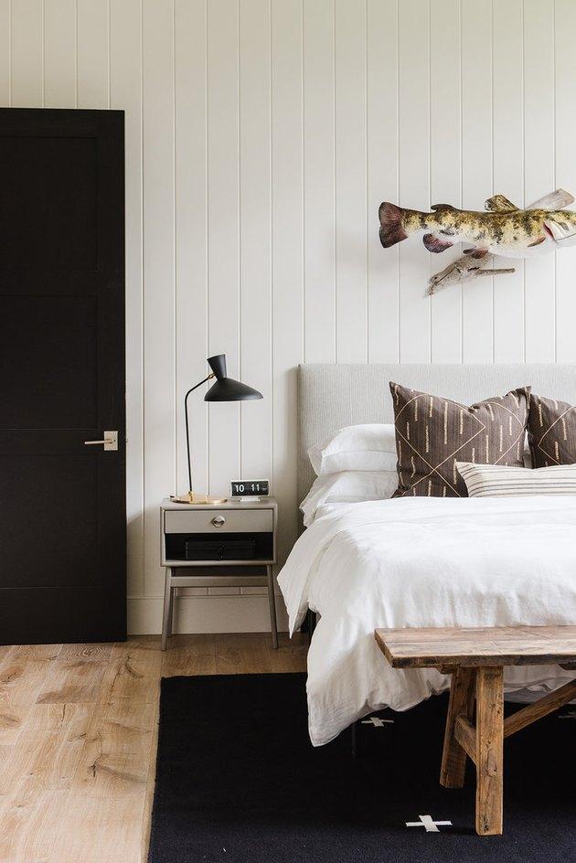 Scandinavian farmhouse bedroom with white shiplap and Scandinavian decor details